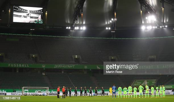 The players of Wolfsburg and Bremen stand for a minutes silence in memory of Argentinian football legend Diego Maradona during the Bundesliga match...