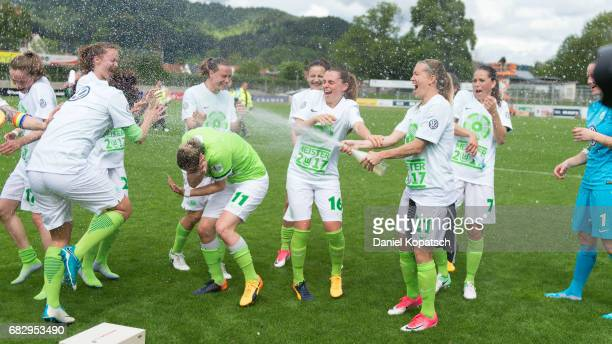 The players of Wolfsburg celebrate after the Women's Bundesliga match between SC Freiburg and VfL Wolfsburg at Moeslestadion on May 14 2017 in...