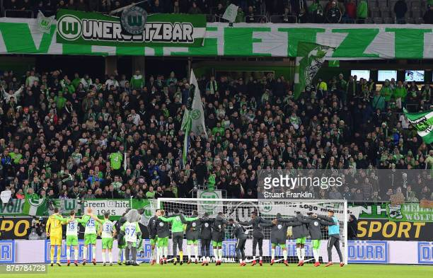 The players of Wolfsburg celebrate before the fans after the Bundesliga match between VfL Wolfsburg and SportClub Freiburg at Volkswagen Arena on...