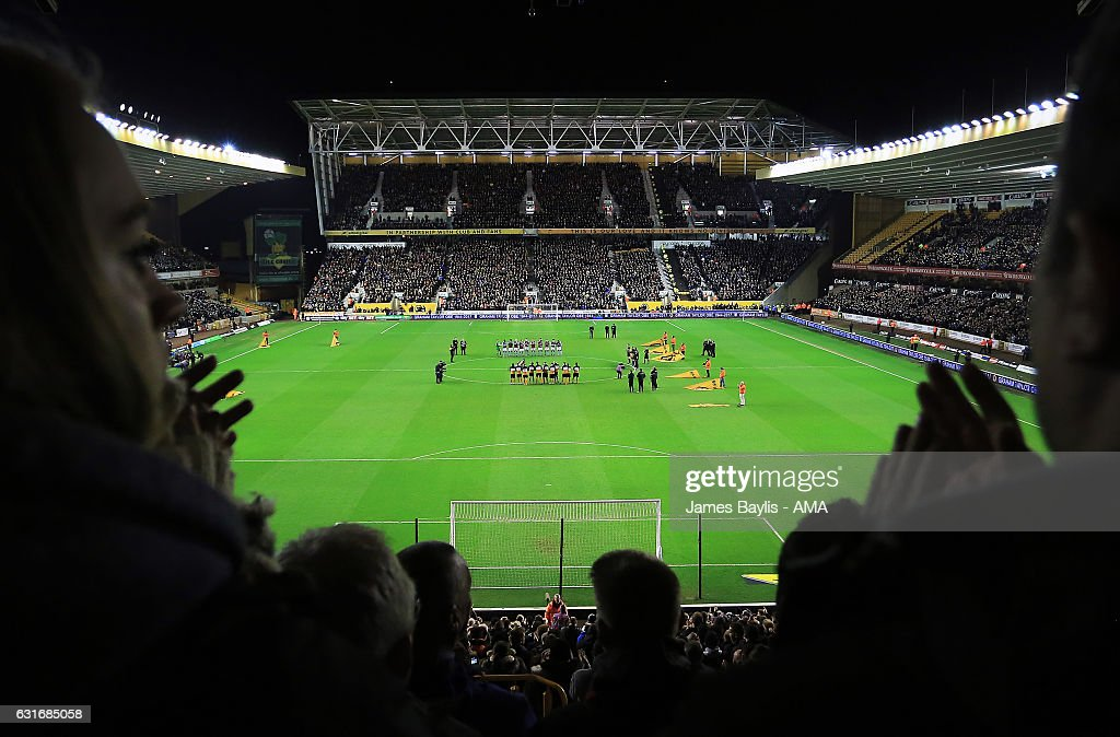 The players of Wolverhampton Wanderers and Aston Villa pay their respects to former manager of both clubs Graham Taylor with a minutes applause before the Sky Bet Championship match between Wolverhampton Wanderers and Aston Villa at Molineux on January 14, 2017 in Wolverhampton, England.