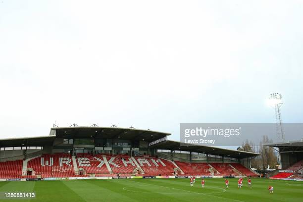 The players of Wrexham walk onto the pitch ahead of the first half during the Vanarama National League match between Wrexham and Aldershot Town at...