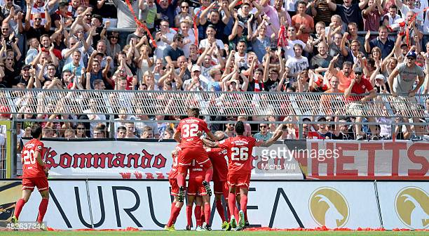 The players of Wuerzburg celebrate the first goal scored by Amir Shapourzadeh during the Third League match between Wuerzburger Kickers and Dynamo...