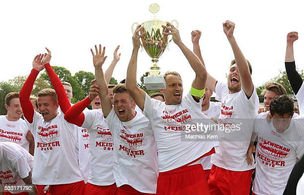 The players of Zwickau celebrate with the trophy after winning the Regionalliga Nordost championship title after the Regionalliga Nordost match...