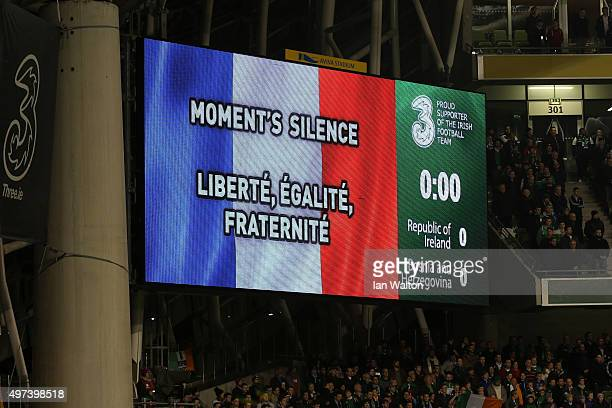 The players officials and fans observe a silence in remembrance to the victims of last weeks terror attacks in Paris prior to kickoff during the UEFA...