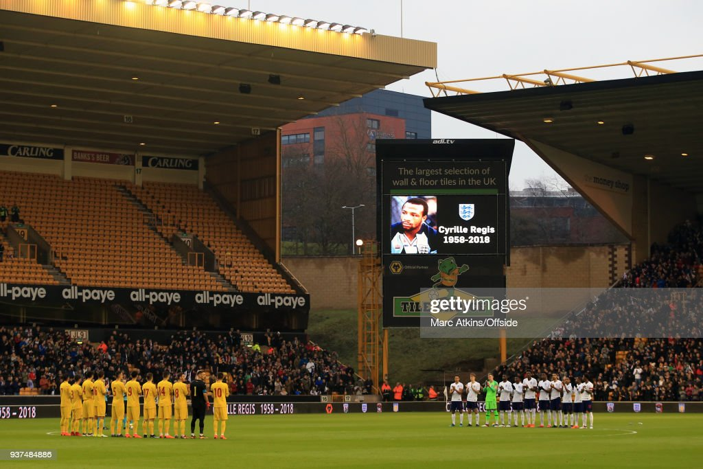 The players pay tribute to the late Cyrille Regis during the U21 International Friendly match between England U21 and Romania U21 at Molineux on March 24, 2018 in Wolverhampton, England.