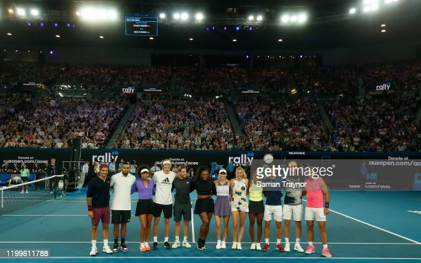 The players pose for a group photo during the Rally for Relief Bushfire Appeal event at Rod Laver Arena on January 15 2020 in Melbourne Australia