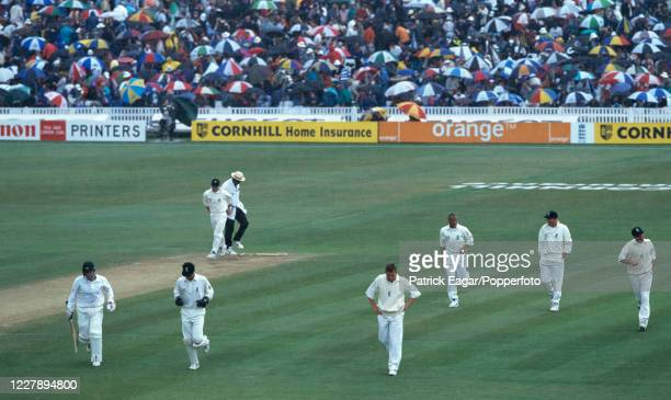 The players run for cover as rain stops play for an hour on day three of the 1st Test match between England and Australia at Edgbaston, Birmingham,...