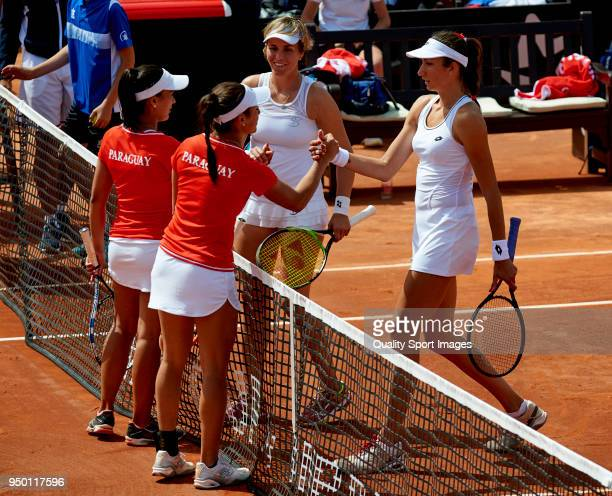 The players shake hands before the doubles match between Veronica Cepede and Montserrat Gonzalez of Paraguay against Maria Jose Martinez and Georgina...