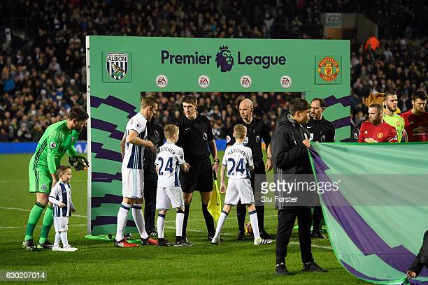 The players shake hands infront of the Premier League board before the Premier League match between West Bromwich Albion and Manchester United at The...