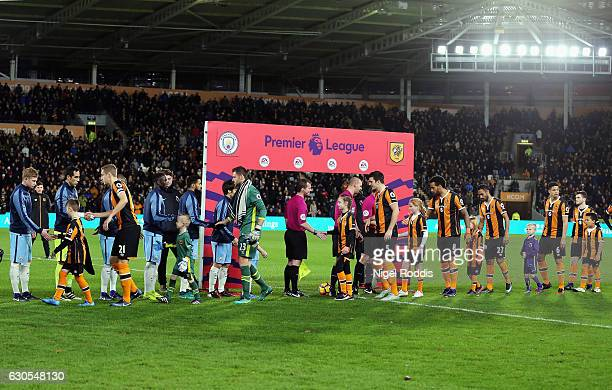 The players shake hands prior to the Premier League match between Hull City and Manchester City at KCOM Stadium on December 26 2016 in Hull England
