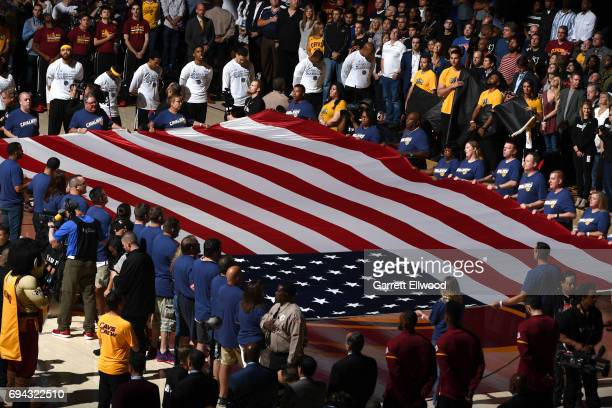 The players stand for the national anthem before the game between the Cleveland Cavaliers and Golden State Warriors in Game Four of the 2017 NBA...