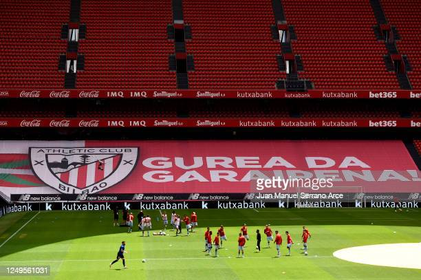 The players take part in the warm-up in front of empty stands before the Liga match between Athletic Club and Club Atletico de Madrid at San Mames...