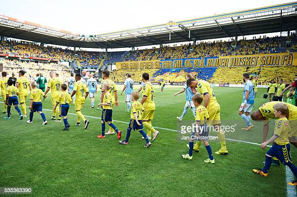 The players walk on to the pitch prior to the Danish Alka Superliga match between Brondby IF and SonderjyskE at Brondby Stadion on May 29 2016 in...
