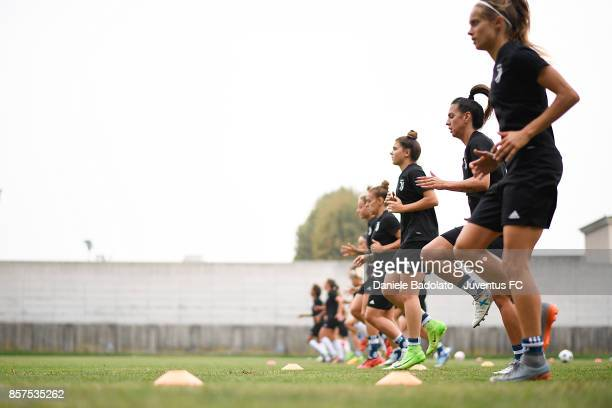 The players warm up during a Juventus Women training session on October 4 2017 in Turin Italy