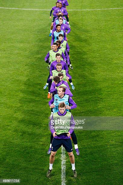 The players warm up during the Tottenham Hotspur training session ahead of the UEFA Europa League match against Anderlecht at Constant Vanden Stock...