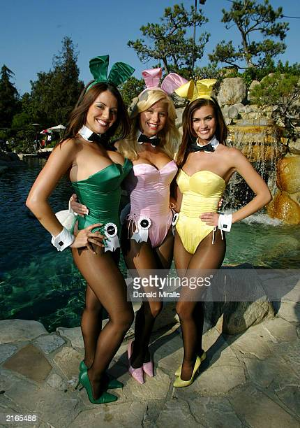 The Playmate Ring Girls pose in front of the entrance of the Grotto during Fight Night at the Playboy Mansion on July 15 2003 in Bel Air California