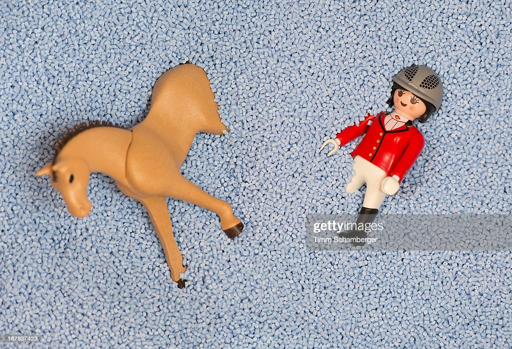 The Playmobil toy figure 'Rider with horse' is covered with plastic granules at the playmobil toy factory in Dietenhofen on November 12, 2013 in Dietenhofen, Germany. The first Playmobil figures were developed by cabinetmaker Hans Beck in the early 1970's and the first Playmobil lineup launched in 1974 by toy manufacturer geobra Brandstaetter. Playmobil, known for its plastic toy action sets of knights, pirates, farmers, firemen, police and Native Americans, will mark its 40th anniversary in 2014.
