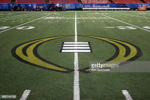 The playoff logo on the field at the College Football Playoff Semifinal at the ChickfilA Peach Bowl between the Washington Huskies and the Alabama...