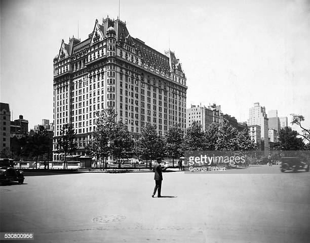 The Plaza Hotel and the beautiful plaza with its fountains and garden seen from 60th Street and Fifth Avenue circa the 1920s
