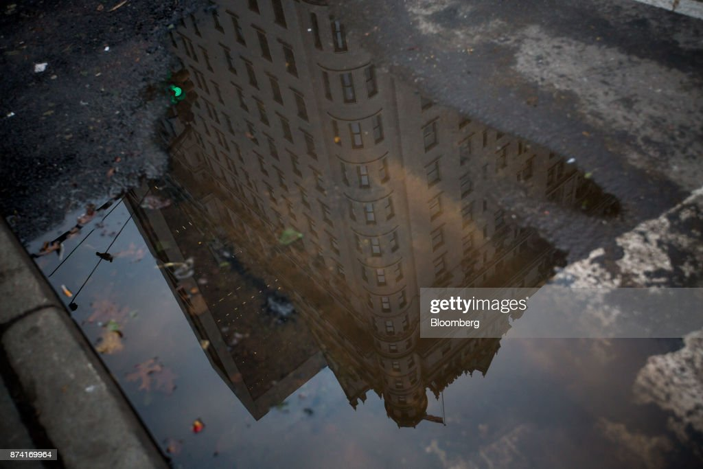 The Plaza Hotel is seen reflected in a puddle in New York, U.S., on Monday, Nov. 13, 2017. Billionaire SaudiPrince Alwaleed bin Talalhas long been associated with New York's iconic Plaza Hotel, ever since he bought out Donald Trumpover two decades ago. Photographer: Michael Nagle/Bloomberg via Getty Images
