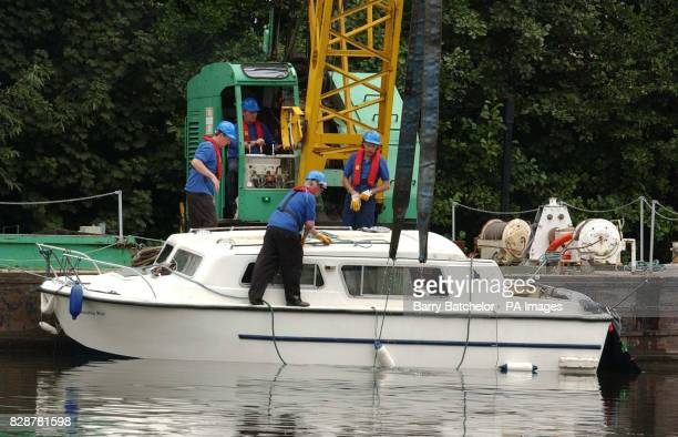 The pleasure boat Sweetie Pie is recovered after it capsized on Saturday night killing a woman on board at StourportonSevern marina Worcestershire...
