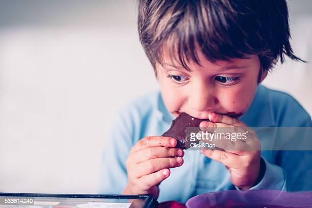 the pleasure of eating chocolate - click&boo fotografías e imágenes de stock