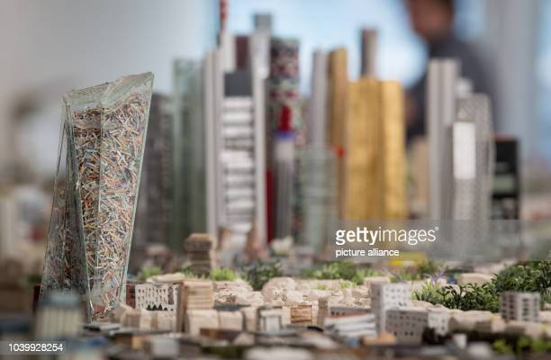 The plexi glas reconstruction of the European Central Bank is filled with shredded bank notes in the new model of the city of Frankfurt Germany 13...