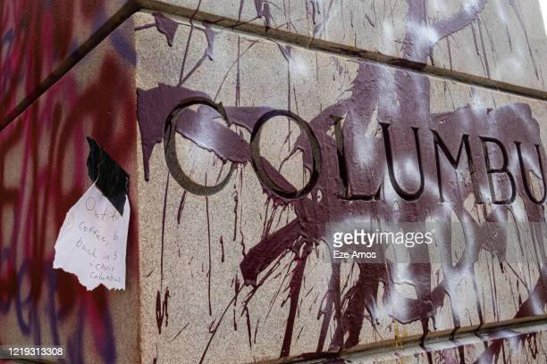 The plinth of a Christopher Columbus statue is shown defaced with paint from ongoing antiracism protests June 10 2020 in Byrd Park In Richmond...