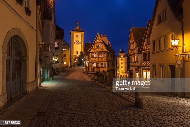 the plonlein (little square) at night - rothenburg stock photos and pictures
