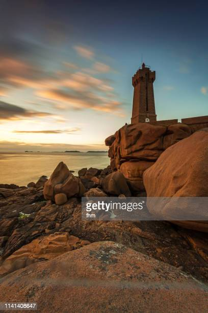 the ploumanac'h lighthouse (officially the mean ruz lighthouse), brittany/ france - cotes d'armor stock photos and pictures