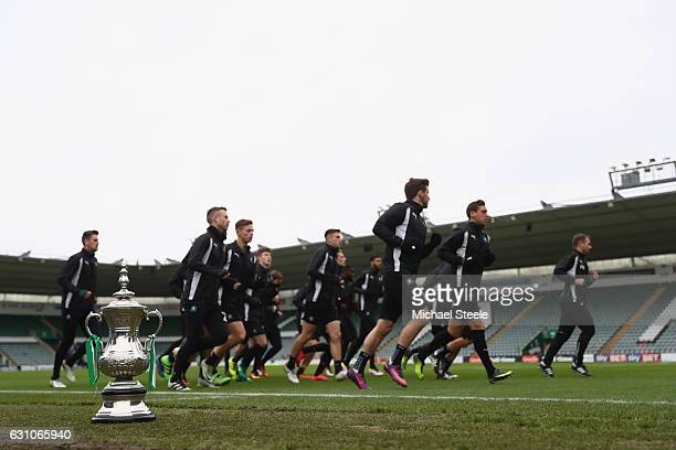 The Plymouth players jog past a replica FA Cup trophy during the Plymouth Argyle Media Access ahead of Emirates the FA Cup 3rd round match against...