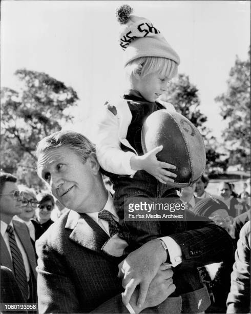 The PM picks up 5 year old Peter Shillinglaw of Caringbah during his walk through the peoplePM Malcolm Fraser attended a Liberal Party picnic at...