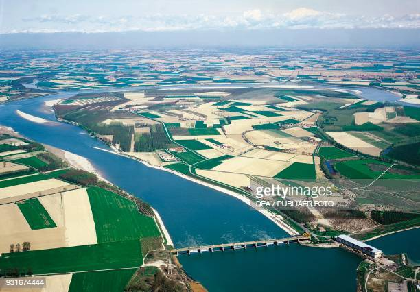The Po river flowing through Cremona between cultivated fields Lombardy Italy