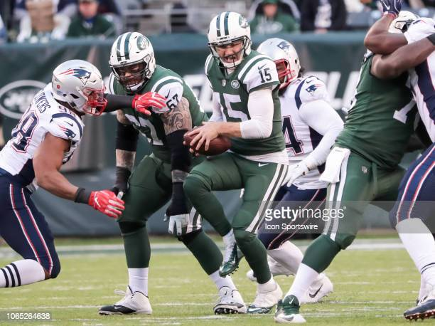 The pocket collapses on New York Jets Quarterback Josh McCown during the National Football League game between the New England Patriots and the New...