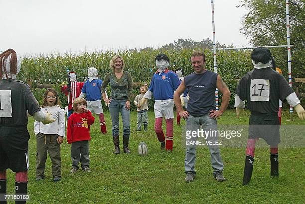 The Pocous family neighbours of the mother of France's rugby union team hooker and captain Raphael Ibanez pose in their garden decorated with France...