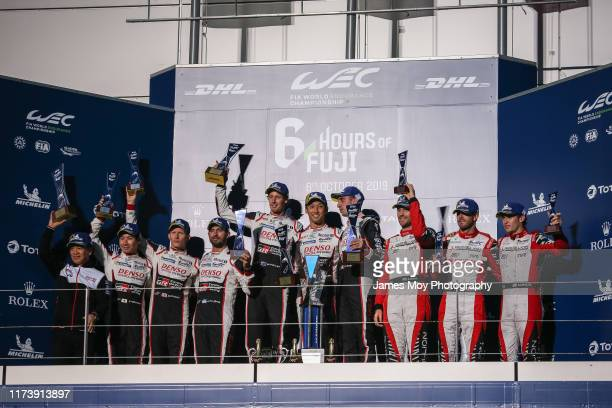 The podium Shigeki Tomoyama of Japan and President of the Gazoo Racing Company Kamui Kobayashi of Japan and Toyota Gazoo Racing Mike Conway of Great...