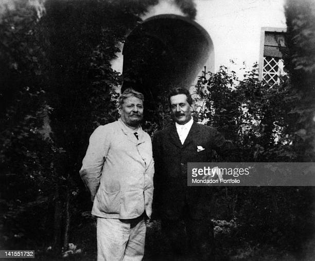 The poet Giovanni Pascoli in front of his home with the composer Giacomo Puccini at Castelvecchio. Barga