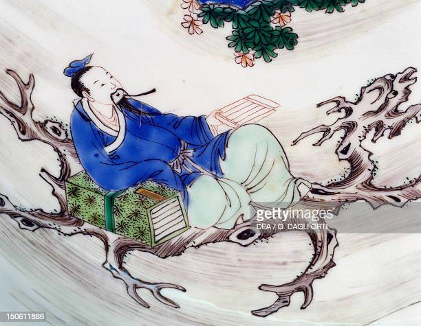 The poet Li Po sitting on a tree branch famille verte large ceramic plate Detail of the decoration China Chinese Civilisation Qing dynasty the...