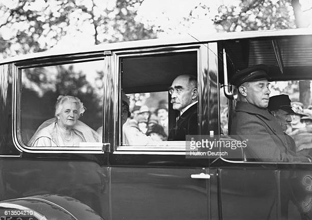 The poet Rudyard Kipling and his wife travel as passengers in a car, to attend the first Court of the Season at Buckingham Palace, 1925.