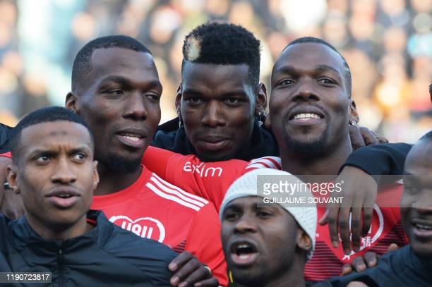 The Pogba brothers Manchester United and France midfielder Paul Pogba Atlanta United defender Florentin Pogba and CD Manchego midfielder Mathias...