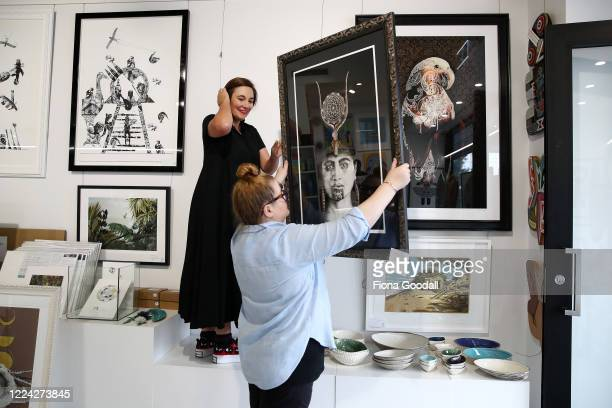 The Poi Room owner MelanieJane Smith and Megan Sadgrove move artwork as they prepare for the Ponsonby store to open at level two on May 12 2020 in...