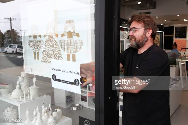 The Poi Room Ponsonby owner Clayton Smith prepares personalised Covid19 signage for customers as they clean and organise the store for reopening at...