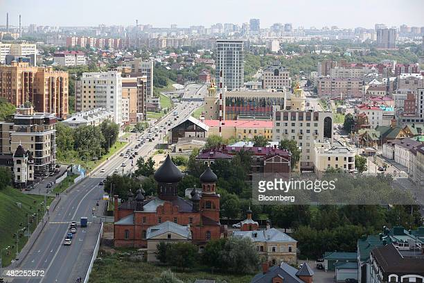 The Pokrovsky cathedral left which translates as Old Believers sits beside a highway on the city skyline in Kazan Russia on Saturday July 25 2015...