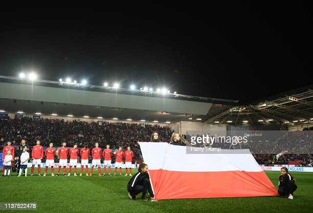 The Poland side line up for the national anthem during the U21 International Friendly match between England and Poland at Ashton Gate on March 21...