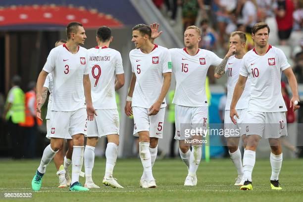 The Poland's players Artur Jedrzejczyk Robert Lewandowski Jan Bednarek Kamil Glik Kamil Grosicki and Grzegorz Krychowiak celebrate the victory after...