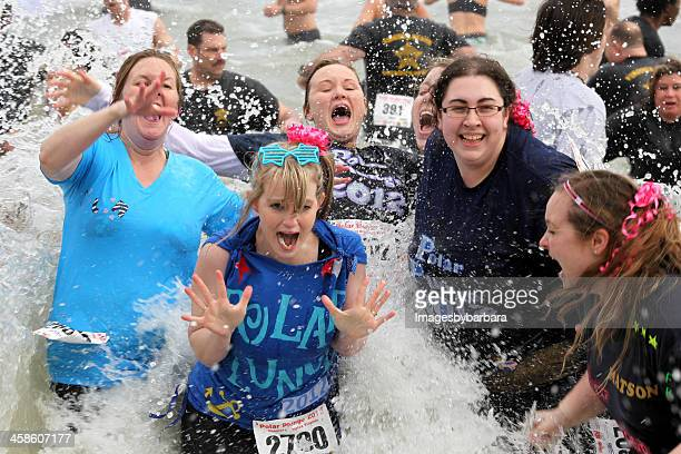 the polar plunge - polar bear plunge stock pictures, royalty-free photos & images