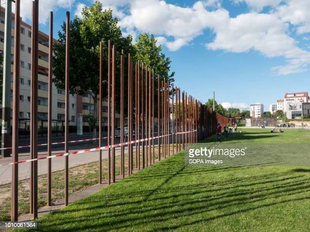 The poles show where the Berlin wall stood The Berlin Wall was built by Soldiers in Bernauer Strasse to divide the city between east and west Germany...