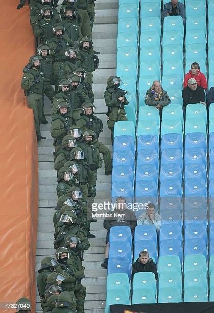 The police and fans watch the Landesliga match between FC Sachsen II and 1.FC Lok Leipzig at the Zentralstadion on October 14, 2007 in Leipzig,...