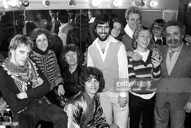 The Police and friends posed backstage at the Bottom Line Club in New York on April 04 1979 after their concert there Stewart Copeland far left Sting...