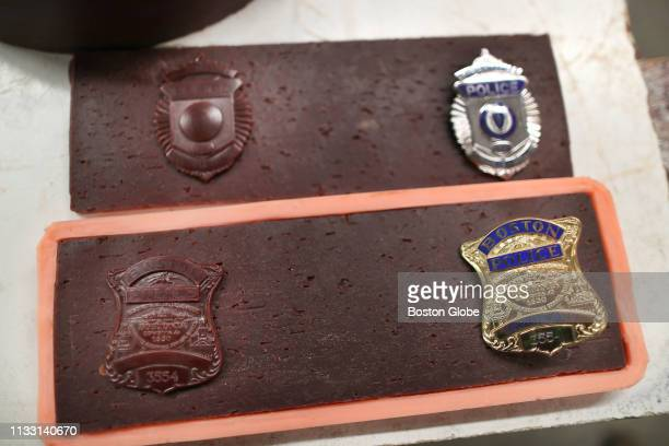 The police badges of MIT officer Sean Collier top and Boston Police officer DJ Simmonds that will be cast in bronze bricks and then placed on the...